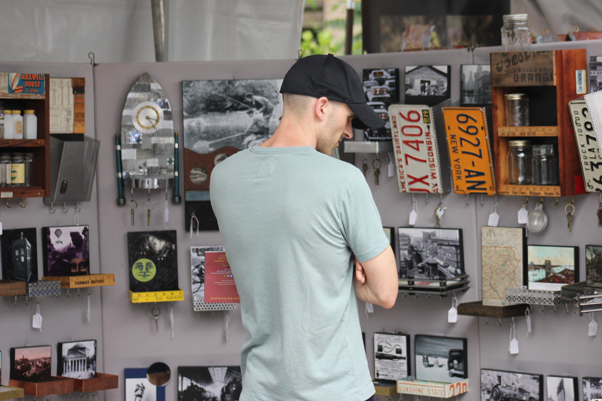 guy looking at stuff market.jpg